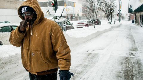 A man warms his hand while running errands in Flint, Michigan, on January 6.
