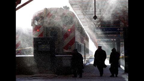 Metra employees in Chicago walk around LaSalle Street Station on January 6.