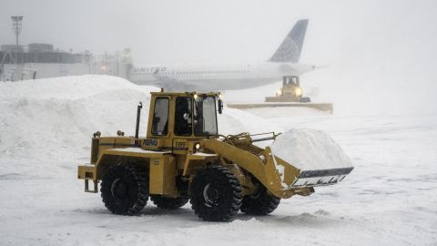 An airport employee clears snow at New York's LaGuardia Airport on January 3.
