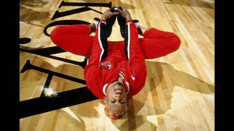 Rodman stretches before a game in Seattle in 1996.