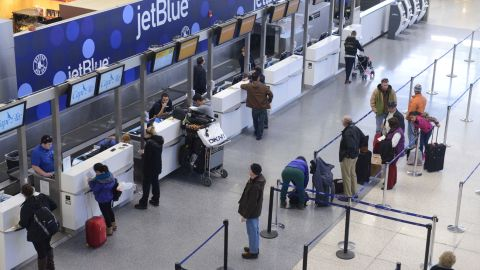 JetBlue passengers wait for normal flights to resume at Logan International Airport in Boston on January 7.