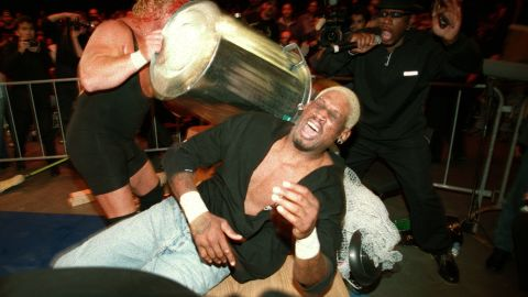Rodman is hit with a trash can by Curt Hennig during a pro wrestling match in Sydney in 2000.
