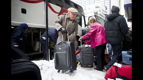 Passengers unload their luggage after arriving at Union Station in Chicago after their Amtrak train from Los Angeles became stuck in snow drifts on Tuesday, January 7.
