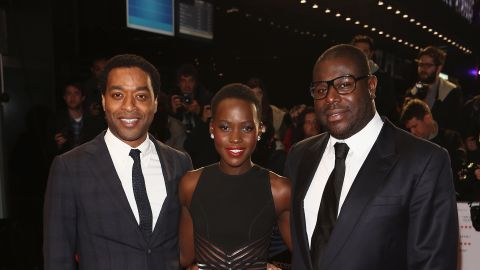 """Nyong'o pictured with """"12 Years"""" star Chiwetel Ejiofor (left) and director Steve McQueen (right) at the movie's European premiere, at the London Film Festival on October 18, 2013."""