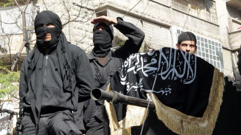 This file photo shows members of jihadist group al-Nusra Front in a parade in Syria in October 2013.