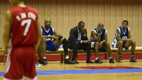 "Former NBA star Eric ""Sleepy"" Floyd, center, sits with fellow American basketball players."