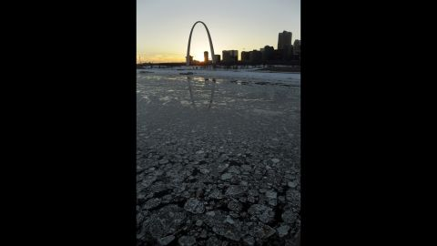 Ice in the Mississippi River flows past the Gateway Arch in St. Louis on January 7.