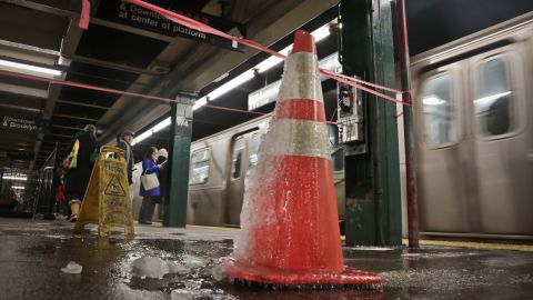 Water dripping from a New York City subway station freezes on a traffic cone January 8.