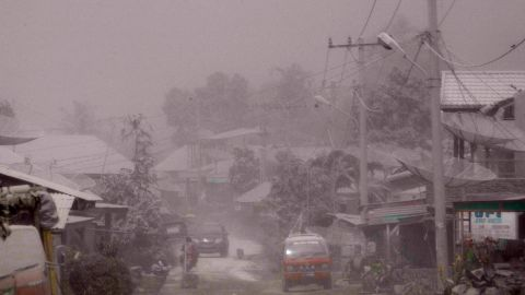 A village is covered in ash.
