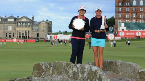 Ko and 2013 British Open champion Stacey Lewis on the famous Swilcan Bridge at St. Andrews with their trophies. Ko was leading amateur and is tipped to win the professional title in future years.