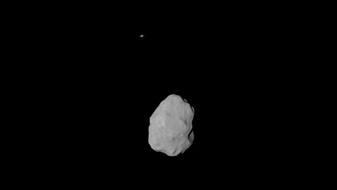 Look closely at the top of this picture. See that dot? That's Saturn. Rosetta snapped the picture of asteroid Lutetia and captured Saturn in the background.