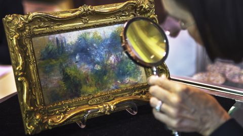 """A 19th-century Renoir painting was stolen from a US museum in 1951 and then bought at a flea market in 2010. A judge later ruled that it to be returned to the museum. The 5½-by-9-inch painting, titled """"Landscape on the Banks of the Seine,"""" was bought for $7 at a flea market by a Virginia woman."""
