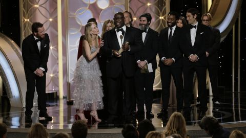 """Director Steve McQueen and the cast of the film """"12 Years a Slave"""" accept the award for best drama."""