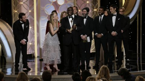 """Director Steve McQueen and cast accept the best motion picture award for the drama """"12 Years a Slave"""" at the Golden Globes."""