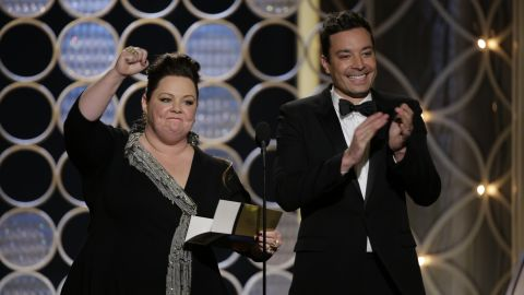 """Melissa McCarthy and Jimmy Fallon present the award for best actor in a miniseries or TV movie. It was won by Michael Douglas for his performance in the HBO movie """"Behind the Candelabra."""""""
