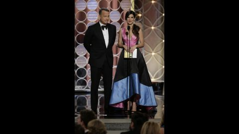"""Tom Hanks and Sandra Bullock present the award for best supporting actress in a motion picture. Jennifer Lawrence won for her role in the movie """"American Hustle."""""""