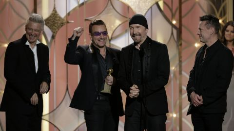 """Adam Clayton, Bono, The Edge and Larry Mullen Jr. of U2 accept the award for best original song. The song """"Ordinary Love"""" was produced by Danger Mouse and is from the film """"Mandela: Long Walk to Freedom."""""""