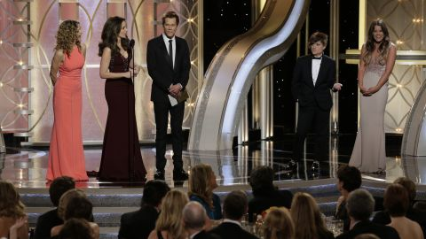 """Kyra Sedgwick, left, and Kevin Bacon, third from left, are interrupted while introducing their daughter Sosie Bacon, right, as this year's Miss Golden Globe. Fey, second from left, jokes that her adult son Randy, played by Poehler, second from right, is Mr. Golden Globe """"in the name of gender equality."""""""