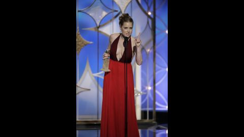 """Amy Adams, who starred in """"American Hustle,"""" accepts the award for best actress in a motion picture (musical or comedy)."""