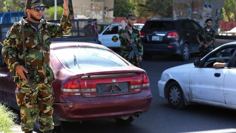 Libyan military personnel man a checkpoint set up to try to secure the capital, Tripoli, on October 20, 2013.