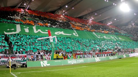 """This banner was held aloft by Legia Warsaw fans during the game with Hapoel Tel Aviv. The banner, which had the Arabic word """"Jihad"""" emblazoned on it, was used to incite visiting supporters."""