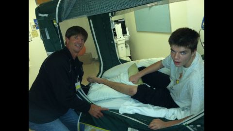 Grant with his father John Virgin. The Virgin family believes fish oil could do for others what it did for their son.
