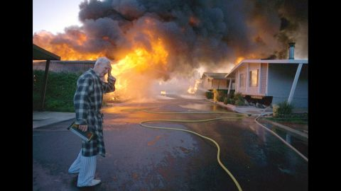 Ray Hudson reacts as a friend's home goes up in flames at the Oak Ridge Trailer Park in Sylmar, California, after a major earthquake hit the San Fernando Valley area of Los Angeles on January 17, 1994.
