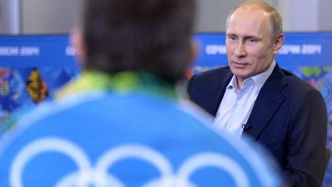Russian President Vladimir Putin meets upcoming Olympic games' volunteers in Sochi on January 17, 2014.