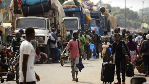 Muslim civilians prepare to board trucks in Bangui to flee the capital on Saturday, January 18.
