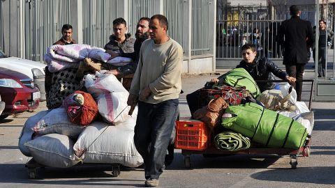 Syrian refugees enter Turkey via the Cilvegozu border gate in Hatay, Turkey, on Saturday, January 18.