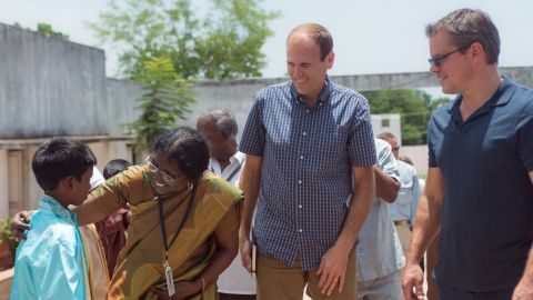 White, left, and Damon visit students and teachers at BWDA Middle School in Kolliyangunam, a village near Chennai, India. Hygiene education programs at this school have reduced the number of sick days for students and encouraged families to improve their sanitation facilities.