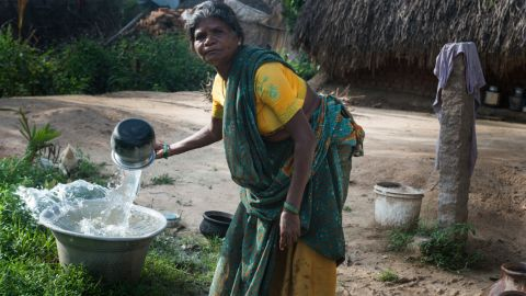 """A woman in Vilupuram, India, washes pots and pans at her new water point. With safe water at her home, she no longer has to make daily trips to the river. Matt Damon and Gary White co-founded <a href=""""http://water.org/"""" target=""""_blank"""" target=""""_blank"""">Water.org</a>, a nonprofit that helps communities achieve sustainable water systems. Click through to see the work they are doing throughout the world:"""