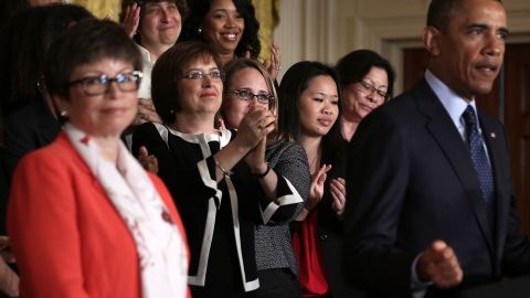 With adviser Valerie Jarrett looking on, President Barack Obama marked the 50th anniversary of the Equal Pay Act in June.