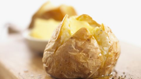 """<strong>Baked potato</strong><br /><br />The potato has been unfairly demonized -- it's actually a potent hunger tamer. In a study that measured the satiating index of 38 foods, including brown rice and whole-wheat bread, people ranked boiled potatoes highest, reporting that they felt fuller and ate less two hours after consuming them. <br /><br />Though potatoes are often shunned because they're considered high in carbohydrates, they shouldn't be. Whether baked or boiled, they're loaded with vitamins, fiber and other nutrients. Result? You get steady energy and lasting fullness after noshing on them.<br /><br /><strong>Feel even fuller:</strong> Eat baked and boiled tubers skin-on to get more fiber for just 160 calories a pop.<br /><br /><a href=""""http://www.health.com/health/gallery/0,,20645136,00.html"""" target=""""_blank"""" target=""""_blank"""">Health.com: 26 reasons to love potatoes </a>"""
