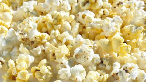 """<strong>Popcorn</strong><br /><br />This movie-night fave is a low-energy-density food -- for 90 calories, you could eat 3 cups of air-popped corn but just a quarter cup of potato chips. """"Popcorn takes up more room in your stomach, and seeing a big bowl of it in front of you tricks you into thinking that you're eating more calories and that you'll feel full when you're finished,"""" Rolls says.<br /><br /><strong>Feel even fuller:</strong> Sprinkle on some red pepper. In a recent Purdue University study, people who added a half teaspoon of the spice to a meal felt less hungry.<br /><br /><a href=""""http://www.health.com/health/gallery/0,,20501331,00.html"""" target=""""_blank"""" target=""""_blank"""">Health.com: 16 ways to lose weight fast</a> <br />"""