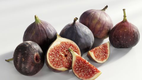 """<strong>Figs</strong><br /><br />A great natural cure for a sweet tooth, fresh figs have a dense consistency and sweet flesh that's high in fiber (each 37-calorie fig packs about a gram), which slows the release of sugar into the blood, preventing the erratic high caused by cookies or cake.<br /><br /><strong>Feel even fuller:</strong> Halve and add protein, like a teaspoon of goat cheese and a walnut.<br /><br /><a href=""""http://www.health.com/health/gallery/0,,20682477,00.html"""" target=""""_blank"""" target=""""_blank"""">Health.com: 20 snacks that burn fat </a>"""