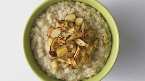 """<strong>Oatmeal</strong><br /><br /><a href=""""http://www.health.com/health/gallery/0,,20306673,00.html"""" target=""""_blank"""" target=""""_blank"""">Oatmeal</a>'s filling force comes from its high fiber content and its uncanny ability to soak up liquid like a sponge. When cooked with water or skim milk, the oats thicken and take more time to pass through your digestive system, meaning you'll go longer between hunger pangs.<br /><br /><strong>Feel even fuller:</strong> Sprinkle almonds on top of your bowl. """"The nuts pack protein and fiber and contain unsaturated fats that can help stabilize insulin levels,"""" regulating blood sugar, Katz says.<br /><br /><a href=""""http://www.health.com/health/gallery/0,,20735735,00.html"""" target=""""_blank"""" target=""""_blank"""">Health.com: 13 comfort foods that burn fat</a>"""