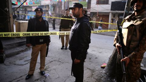 Pakistani soldiers and policement block off the site of suicide bomb attack in Rawalpindi on January 20.