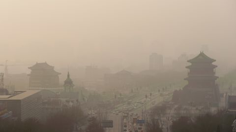 """Vehicles move slowly through heavy smog in Beijing on Thursday, January 16. China's manufacturing of exports generates pollution that harms air quality -- not only in Asia but also all the way across the Pacific Ocean in the <a href=""""http://www.cnn.com/2014/01/20/health/pollution-china-pnas/index.html"""">Western United States</a>, according to a new study."""