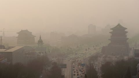 Vehicles move slowly on a road in heavy smog in Beijing, China, 16 January 2014. Beijing Mayor Wang Anshun declared an all-out effort on Thursday (16 January 2014) to tackle air pollution by cutting coal use by 2.6 million tonnes and transforming 300 polluting companies this year. Coal-burning boilers inside Beijings fifth ring road will be eliminated and measures taken against coal burning in the capitals periphery, said Wang at the opening of the annual session of the municipal Peoples Congress, Beijings legislature. Four large gas-burning thermoelectricity centers will be completed, he said. Smog enveloped Beijing on Thursday. Air quality hit the most polluted level. Nowhere was immune, as fog smothered provinces in east and south of the country. Beijing released a five-year clean air action plan (2013-2017) in September. In 2013, the city cut major air pollutants by more than three percent; replaced 366,000 old vehicles; and overhauled288 polluting factories.
