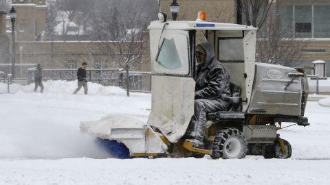 A worker clears snow off sidewalks at Xavier University in Cincinnati, Ohio, on January 21.