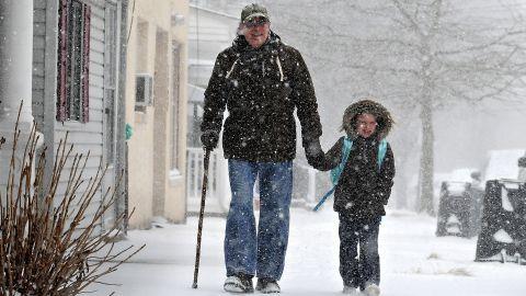 Tony Ciambrello and his granddaughter Addie Maurer walk home from St. Mark's Catholic School in Bristol Borough, Pennsylvania, on January 21.