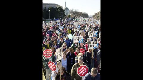 Activists march on Constitution Avenue in Washington on January 22, 2002. Estimates of the crowd's size vary, but it seems safe to say tens of thousands have attended the annual protest.