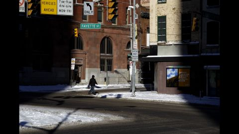 A man crosses a street in downtown Baltimore on January 22.
