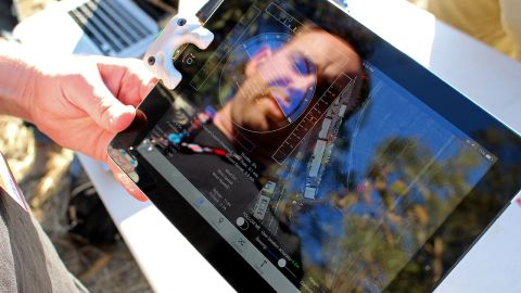 """<a href=""""http://www.fightingwalrus.com/"""" target=""""_blank"""" target=""""_blank"""">Fighting Walrus</a> co-founder Andy Brown demonstrates his company's iPad accessory (mounted on the left side of the tablet), a $129 device for controlling and communicating with drones."""