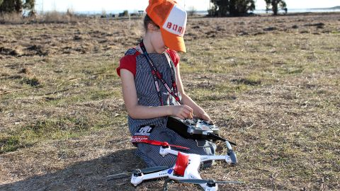 """Zolie Sarriugarte, 7, gets ready to take a drone for a spin. Sarriugarte likes drones because """"if there's a ball stuck up in a tree you can go fly over and knock the ball out."""""""