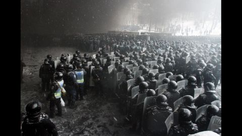 Riot police officers gather as they clash with protesters in the center of Kiev on January 22.