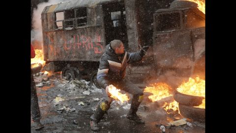 A protester throws a Molotov cocktail during clashes with police in central Kiev.