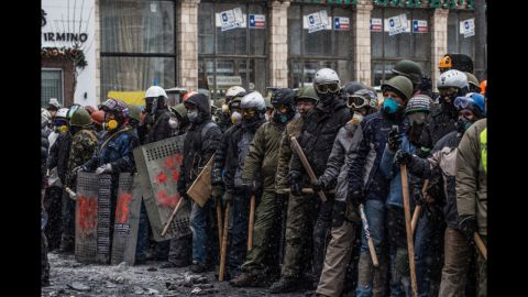 Ukrainian protesters are seem during a mass action of opposition on Grushevsky Street.