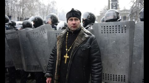 A Ukrainian man stands in front of riot police on January 22.
